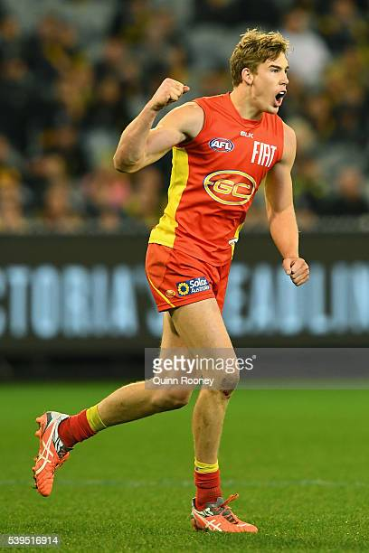 Tom Lynch of the Suns celebrates after kicking a goal during the round 12 AFL match between the Richmond Tigers and the Gold Coast Suns at Melbourne...