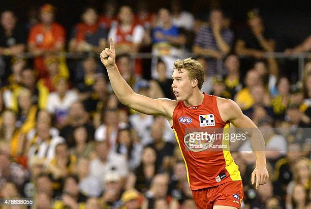 Tom Lynch of the Suns celebrates after kicking a goal during the round one AFL match between the Gold Coast Suns and the Richmond Tigers at Metricon...
