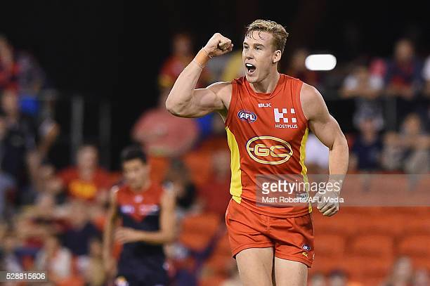 Tom Lynch of the Suns celebrates kicking a goal during the round seven AFL match between the Gold Coast Suns and the Melbourne Demons at Metricon...