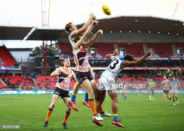 Tom Lynch of the Suns competes for the ball against Phil Davis of the Giants during the round 12 AFL match between the Greater Western Sydney Giants...
