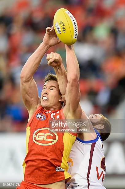 Tom Lynch of the Suns competes for the ball during the round 16 AFL match between the Gold Coast Suns and the Brisbane Lions at Metricon Stadium on...