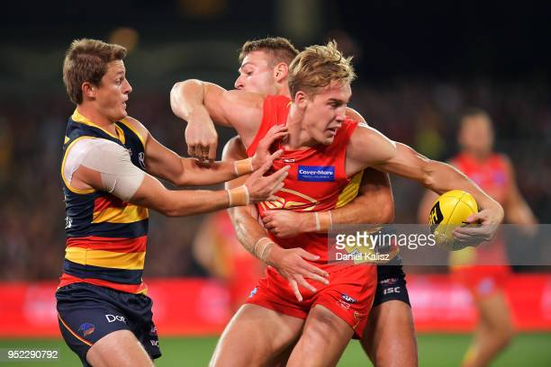 Tom Lynch of the Suns is tackled by Josh Jenkins of the Crows during the round six AFL match between the Adelaide Crows and Gold Coast Suns at...