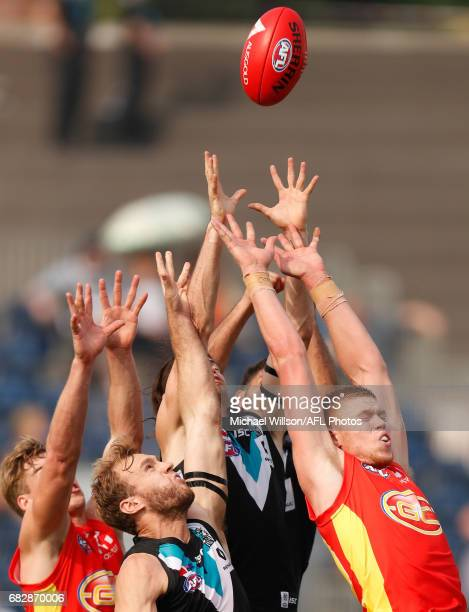 Tom Lynch of the Suns Jack Hombsch of the Power Jasper Pittard of the Power and Peter Wright of the Suns compete for the ball during the 2017 AFL...