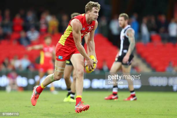 Tom Lynch of the Suns kicks during the round 13 AFL match between the Gold Coast Suns and the St Kilda Saints at Metricon Stadium on June 16 2018 in...