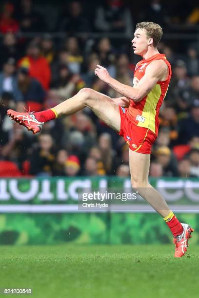 Tom Lynch of the Suns kicks during the round 19 AFL match between the Gold Coast Suns and the Richmond Tigers at Metricon Stadium on July 29 2017 in...
