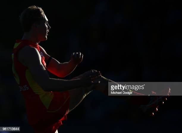 Tom Lynch of the Suns kicks the ball for a goal during the round 14 AFL match between the Hawthorn Hawks and the Gold Coast Suns at University of...