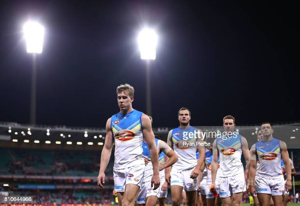 Tom Lynch of the Suns leads his team from the ground after the round 16 AFL match between the Sydney Swans and the Gold Coast Suns at Sydney Cricket...
