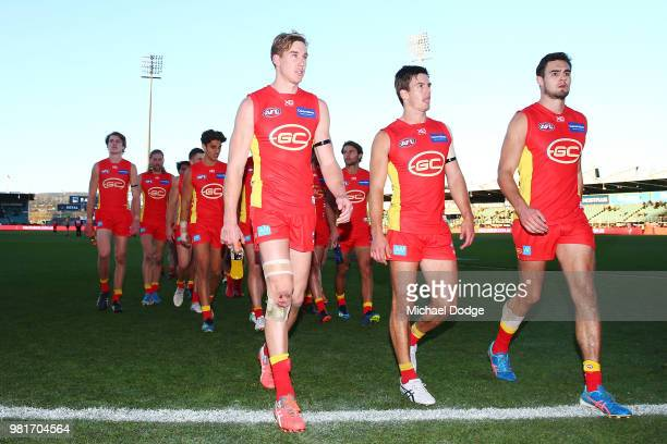 Tom Lynch of the Suns looks dejected after defeat during the round 14 AFL match between the Hawthorn Hawks and the Gold Coast Suns at University of...