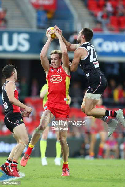 Tom Lynch of the Suns marks during the round 13 AFL match between the Gold Coast Suns and the St Kilda Saints at Metricon Stadium on June 16 2018 in...