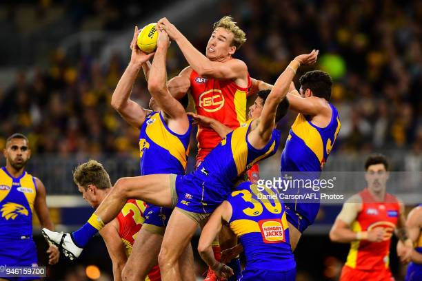 Tom Lynch of the Suns rises for a mark attempt during the 2018 AFL Round 04 match between the West Coast Eagles and the Gold Coast Suns at Optus...
