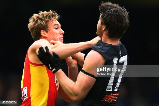 Tom Lynch of the Suns wrestles with Sam Rowe of the Blues during the round 20 AFL match between the Carlton Blues and the GOld Coast Titans at Etihad...