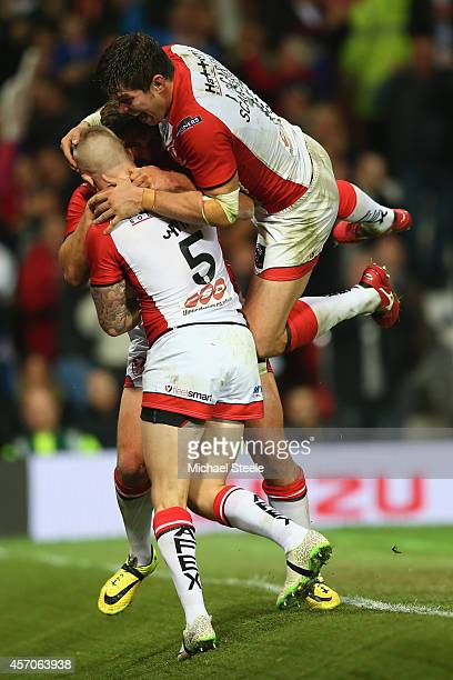 Tom Makinson of St Helens is smothered by Louie McCarthyScarsbrook and Adam Swift after scoring the crucial second try during the First Utility Super...