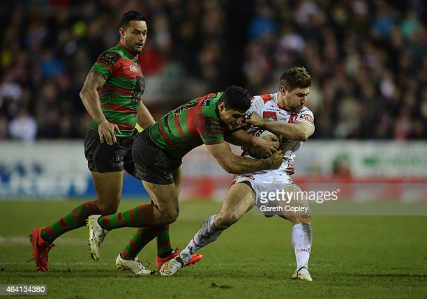 Tom Makinson of St Helens is tackled by Bryson Goodwin of South Sydney Rabbitohs during the World Club Challenge match between St Helens and South...