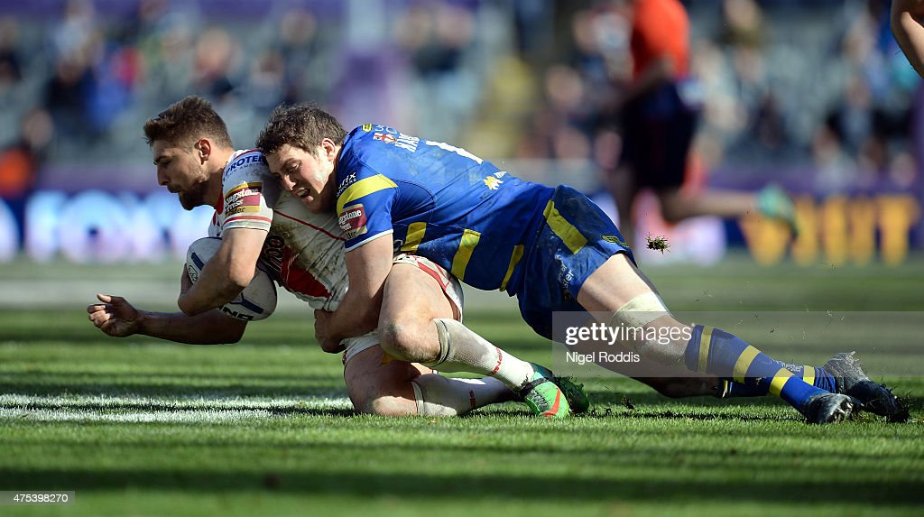 Tom Makinson (L) of St Helens tackled by Ben Harrison of Warrington Wolves during the Super League match between St Helens and Warrington Wolves at St James' Park on May 31, 2015 in Newcastle upon Tyne, England.