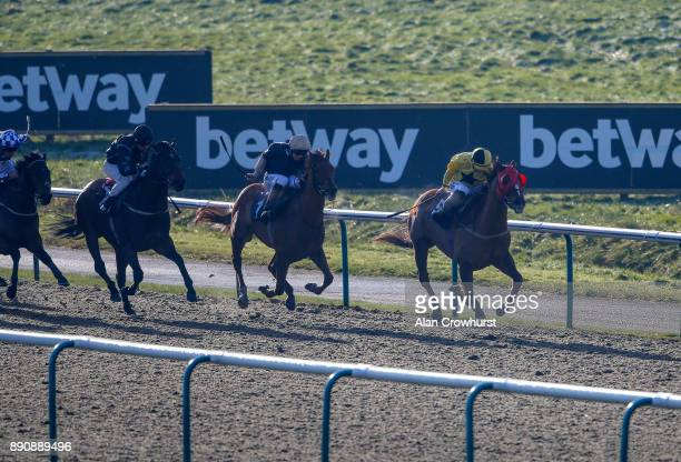 Tom Marquand riding Compton Prince win The Betway Sprint Handicap Stakes at Lingfield Park racecourse on December 12 2017 in Lingfield United Kingdom
