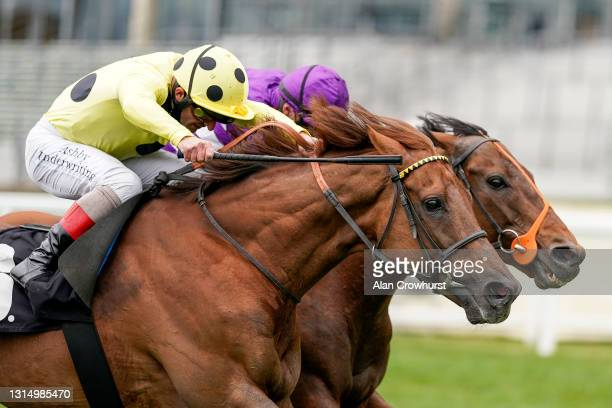 Tom Marquand riding Oh This Is Us win The Charlie Waller Trust Paradise Stakes from Andrea Atzeni riding Prince Eiji at Ascot Racecourse on April 28,...