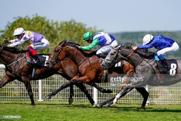 Tom Marquand riding One Master get up on the line to win The Saint Clair Oak Tree Stakes at Goodwood Racecourse on July 31 2020 in Chichester England...