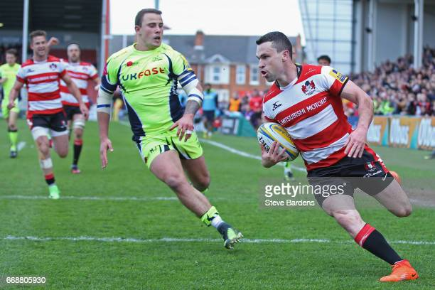 Tom Marshall of Gloucester Rugby scores the opening try during the Aviva Premiership match between Gloucester Rugby and Sale Sharks at Kingsholm...