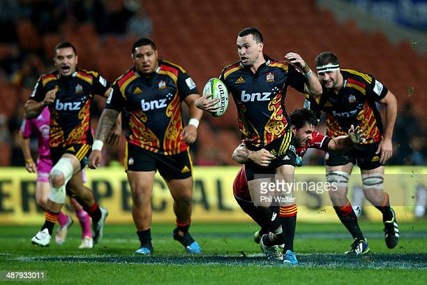 Tom Marshall of the Chiefs is tackled by Robbie Coetzee of the Lions during the round 12 Super Rugby match between the Chiefs and the Lions at...