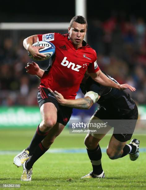 Tom Marshall of the Crusaders fends off Hadleigh Parkes of the Kings during the round six Super Rugby match between the Crusaders and the Kings at...