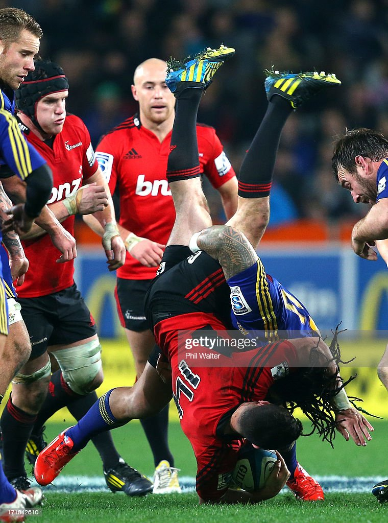 Tom Marshall of the Crusaders is dumped by Ma'a Nonu of the Highlanders during the round 18 Super Rugby match between the Highlanders and the Crusaders at Forsyth Barr Stadium on June 29, 2013 in Dunedin, New Zealand.
