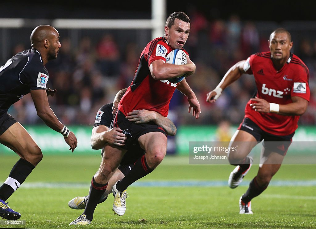 Tom Marshall of the Crusaders runs through the tackle of Hadleigh Parkes of the Kings during the round six Super Rugby match between the Crusaders and the Kings at AMI Stadium on March 23, 2013 in Christchurch, New Zealand.