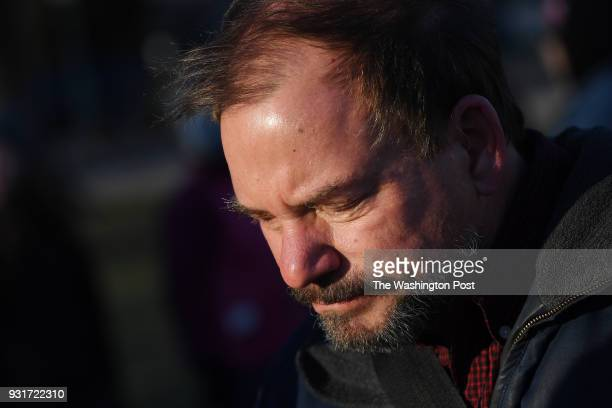 Tom Mauser the father of Columbine High School shooting victim Daniel Mauser is interviewed as people gather to lay out approximately 7000 pairs of...