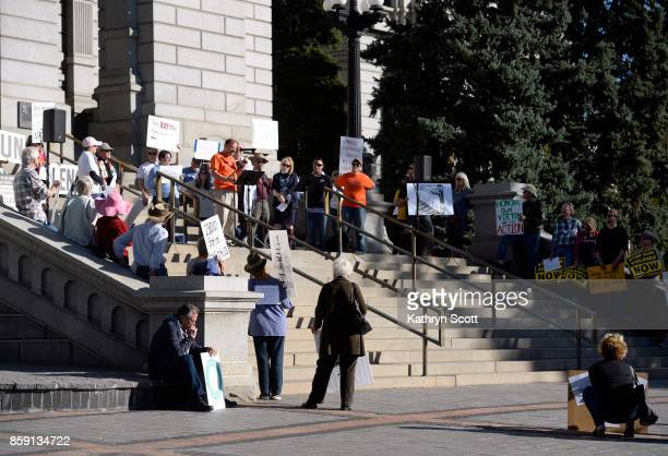 Tom Mauser whose son Daniel died in the Columbine shooting addresses a small crowd gathering on the west steps of the state capitol to join the...