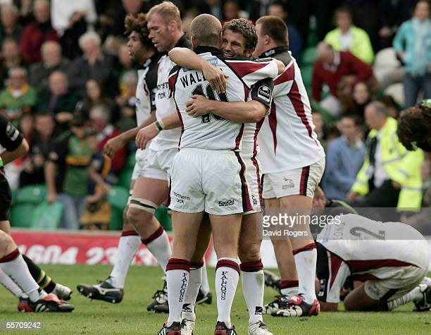 Tom May and Dave Walder of Newcastle celebrate their victory at the final whistle of the Guinness Premiership match between Northampton Saints and...