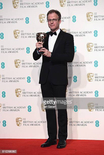 Tom McCarthy winner of Best Original Screenplay for 'Spotlight' poses in the winners room at the EE British Academy Film Awards at the Royal Opera...