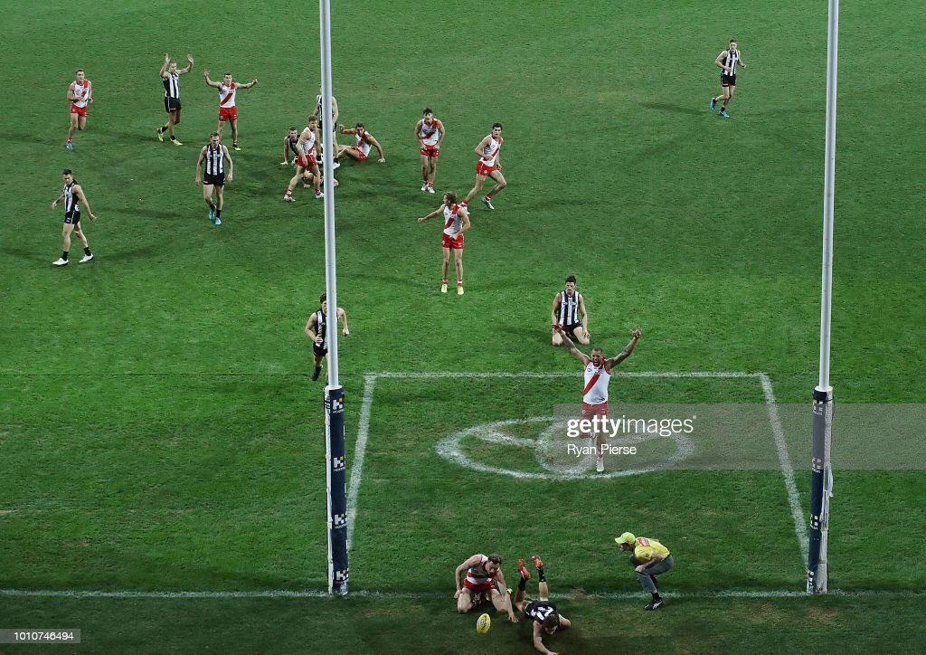 Tom McCartin and Lance Franklin of the Swans of the Swans celebrate after McCartin kicked the winning goal during the round 20 AFL match between the Sydney Swans and the Collingwood Magpies at Sydney Cricket Ground on August 4, 2018 in Sydney, Australia.
