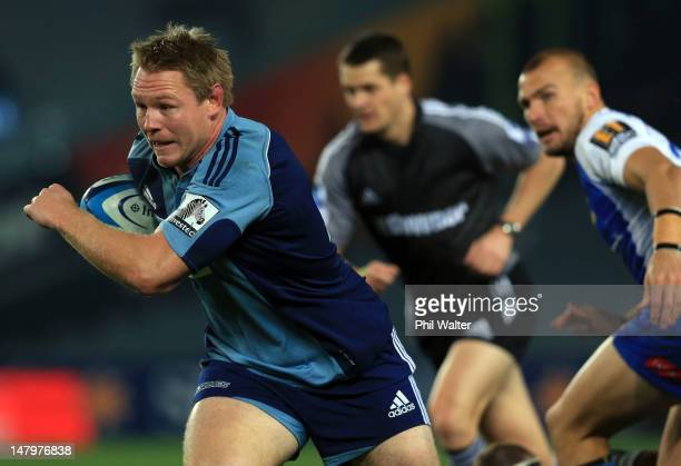 Tom McCartney of the Blues breaks away during the round 17 Super Rugby match between the Blues and the Force at Eden Park on July 7 2012 in Auckland...