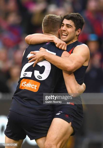 Tom McDonald and Christian Petracca of the Demons celebrate a goal during the round 23 AFL match between the Melbourne Demons and the Greater Western...