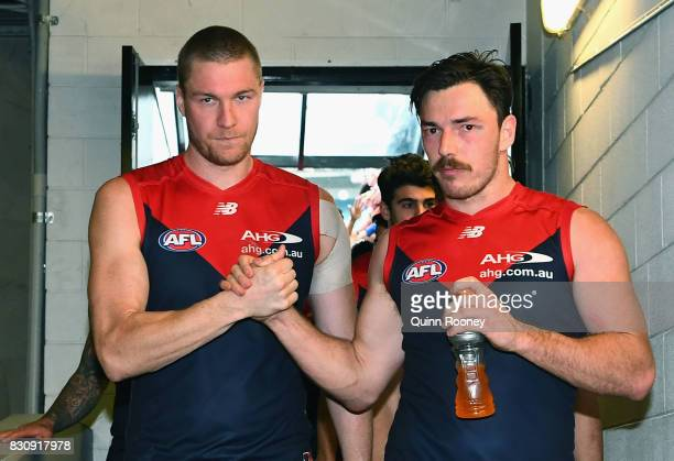 Tom McDonald and Michael Hibberd of the Demons celebrate winning the round 21 AFL match between the Melbourne Demons and the St Kilda Saints at...