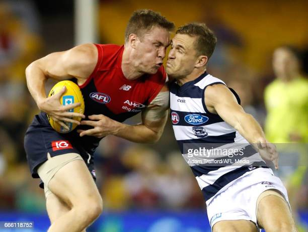 Tom McDonald of the Demons and Joel Selwood of the Cats compete for the ball during the 2017 AFL round 03 match between the Geelong Cats and the...