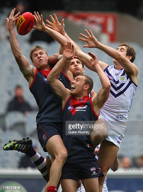 Tom McDonald of the Demons attempts to mark during the round 21 AFL match between the Melbourne Demons and the Fremantle Dockers at Melbourne Cricket...