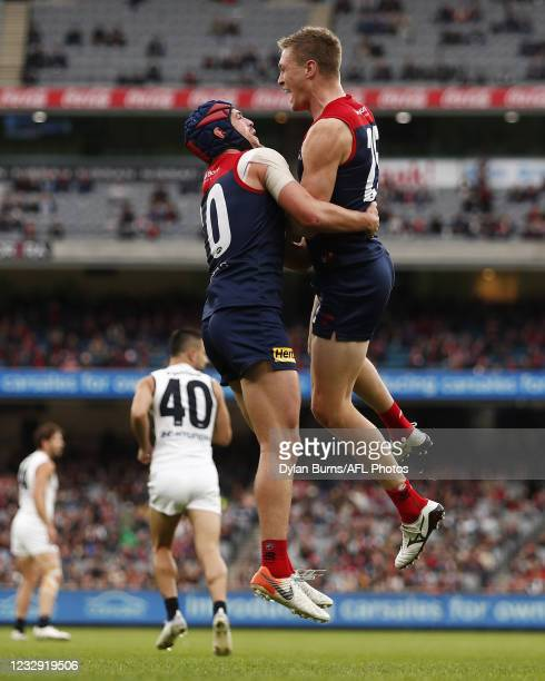 Tom McDonald of the Demons celebrates a goal with Angus Brayshaw of the Demons during the 2021 AFL Round 09 match between the Melbourne Demons and...