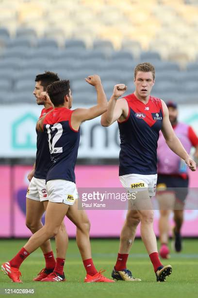 Tom McDonald of the Demons celebrates a goal with Toby Bedford during the round 1 AFL match between the West Coast Eagles and the Melbourne Demons at...