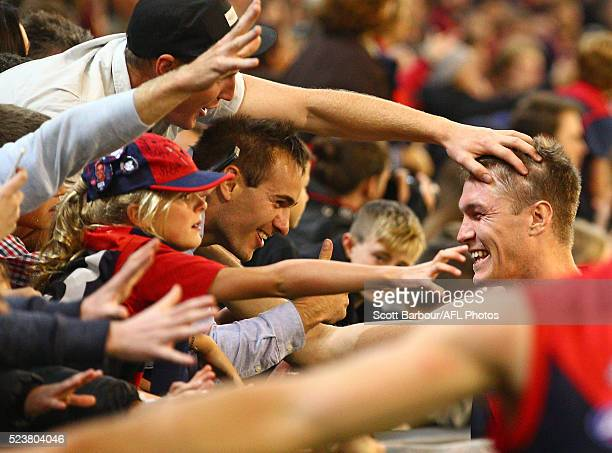 Tom McDonald of the Demons celebrates with supporters in the crowd after winning the round five AFL match between the Melbourne Demons and the...