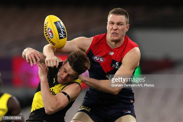 Tom McDonald of the Demons competes with Jayden Short of the Tigers during the round 5 AFL match between the Melbourne Demons and the Richmond Tigers...