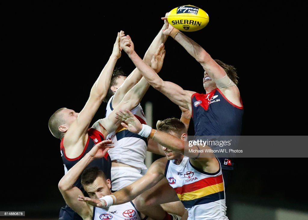 Tom McDonald of the Demons, Jake Lever of the Crows, Brodie Smith of the Crows, Daniel Talia of the Crows and Mitch Hannan of the Demons compete for the ball during the 2017 AFL round 17 match between the Melbourne Demons and the Adelaide Crows at TIO Stadium on July 15, 2017 in Darwin, Australia.