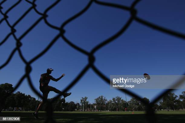 Tom McDonald of the Demons kicks the ball during a Melbourne Demons AFL training session at Gosch's Paddock on November 29 2017 in Melbourne Australia