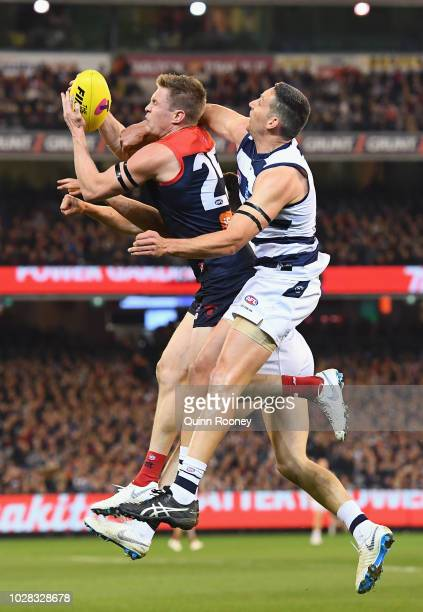 Tom McDonald of the Demons marks infront of Harry Taylor of the Cats during the AFL First Elimination Final match between the Melbourne Demons and...