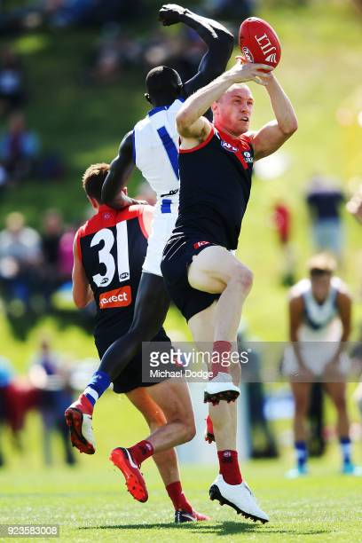 Tom McDonald of the Demons marks the ball against Majak Daw of the Kangaroos during the JLT Community Series AFL match between the North Melbourne...