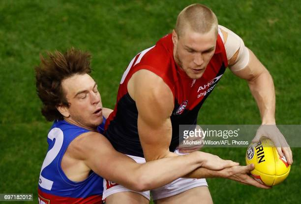 Tom McDonald of the Demons marks the ball over Liam Picken of the Bulldogs during the 2017 AFL round 13 match between the Western Bulldogs and the...