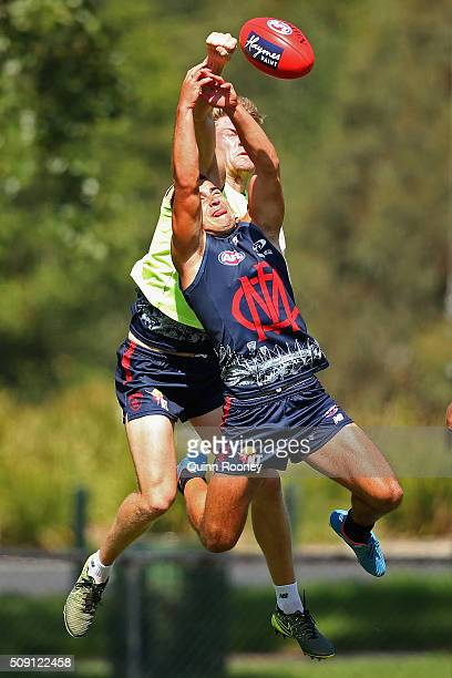 Tom McDonald of the Demons spoils a mark by Ben Kennedy during a Melbourne Demons AFL preseason training session at Gosch's Paddock on February 9...