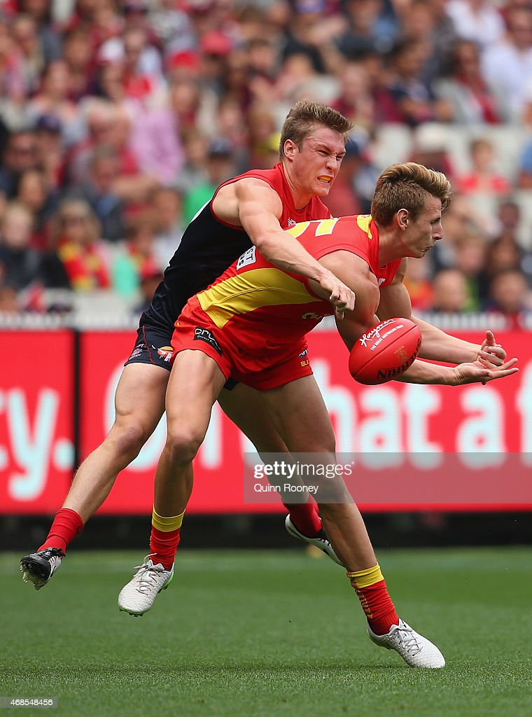 Tom McDonald of the Demons spoils a mark by Daniel Gorringe of the Suns during the round one AFL match between the Melbourne Demons and the Gold Coast Suns at Melbourne Cricket Ground on April 4, 2015 in Melbourne, Australia.