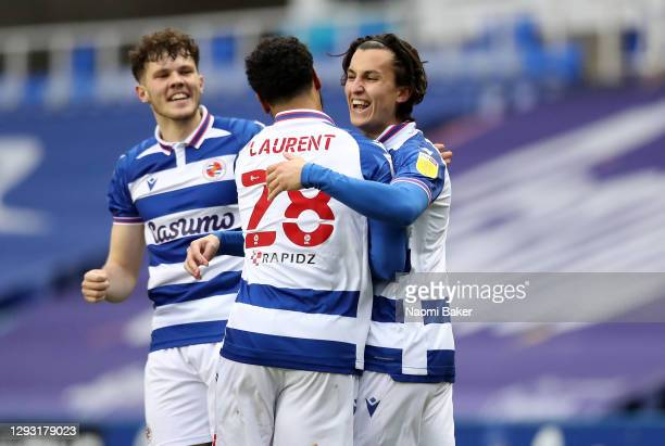 Tom McIntyre of Reading celebrates with teammate Josh Laurent after scoring their sides first goal during the Sky Bet Championship match between...