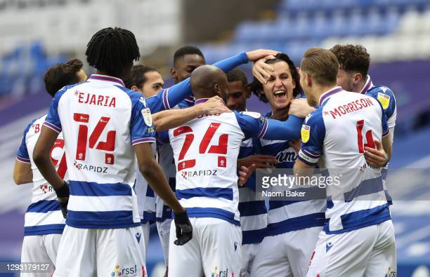 Tom McIntyre of Reading celebrates with teammates after scoring their sides first goal during the Sky Bet Championship match between Reading and...