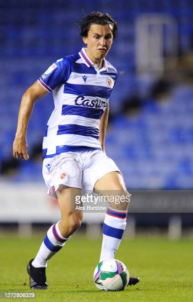 Tom McIntyre of Reading FC passes the ball during the Carabao Cup Second Round match between Reading and Luton Town at Madejski Stadium on September...